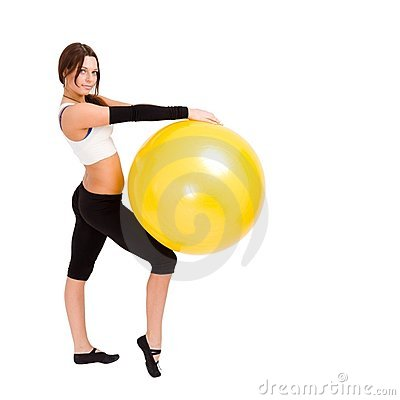 Sportswoman with big fitness ball