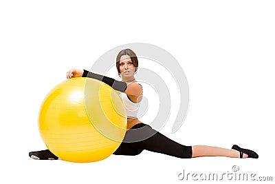 Sportswoman with big fitness ball