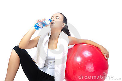 Sportswoman with bottle of pure water
