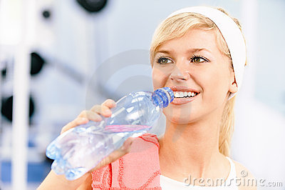 Sportswoman drinks water