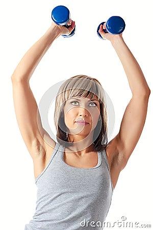 Sportswoman with dumbbells