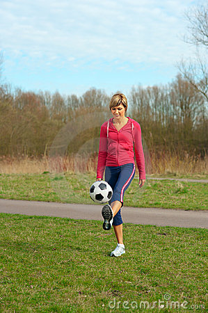 Sportswoman Playing with a Ball