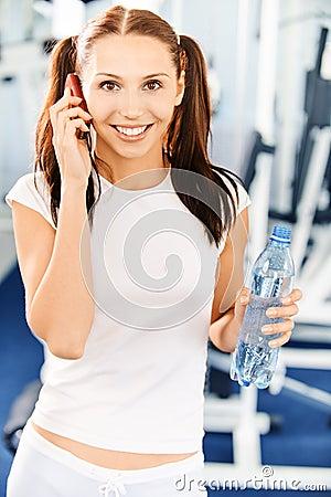 Sportswoman speaks on phone