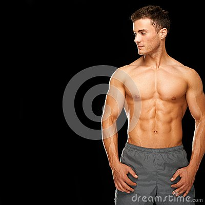 Free Sporty And Healthy Muscular Man Isolated On Black Royalty Free Stock Image - 25262196