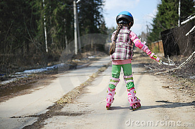 Sporty child girl on roller skates