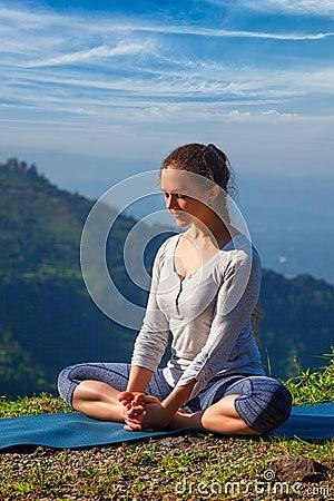 Free Sporty Fit Woman Practices Yoga Asana Baddha Konasana Outdoors Royalty Free Stock Image - 74753846