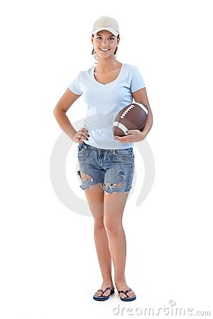 Sporty girl with American football smiling
