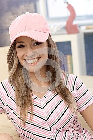 Sporty girl in baseball cap smiling