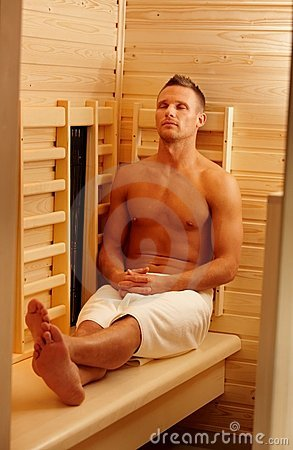 Sporty man enjoying sauna
