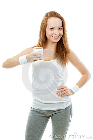 Sporty Smiling Girl Holding A Glass Of Milk
