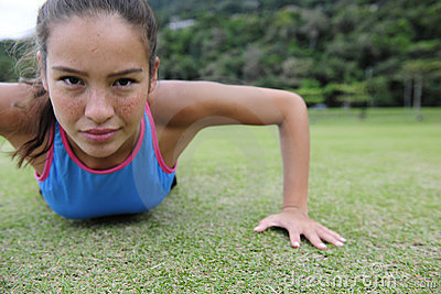 Sporty woman doing push-ups