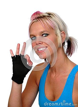 Sporty woman gesturing okay