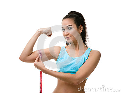 Sporty woman measures her bicep