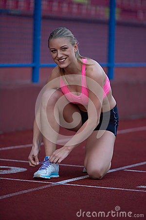 Free Sporty Woman On Athletic Race Track Royalty Free Stock Photo - 54709255
