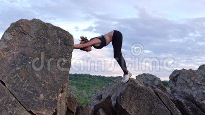 sporty woman practicing yoga and gymnastics exercises on