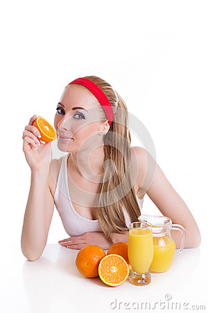 Sporty woman sitting with orange juice