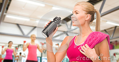 Sporty woman with special sportsman bottle