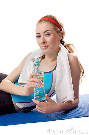 Sporty woman with towel and water
