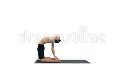 young man doing yoga on a green screen chroma key stock