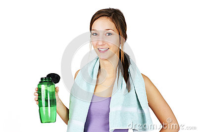 Sporty young woman with water