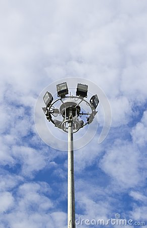 Spot-light tower in blue sky