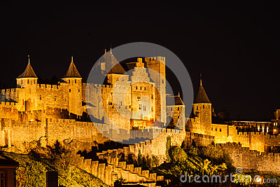 Spotlights illuminate medieval walls and towers