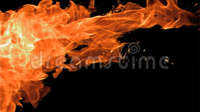 Spray of fire in super slow motion appearing. Against a black background stock video footage