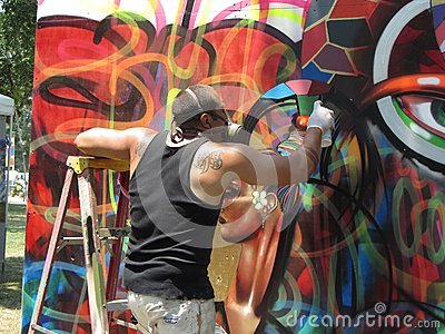 Spray Painting a Mural Editorial Photo