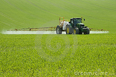 Spraying the field Editorial Stock Image