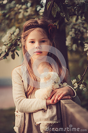 Free Spring Country Portrait Of Adorable Dreamy Kid Girl Near Wooden Fence With Teddy Bear Royalty Free Stock Photo - 63997295
