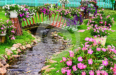 Spring flowers in  garden with a pond