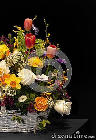 Spring flowers in wicker basket