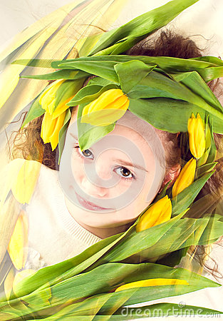 young girl with flowers tulips