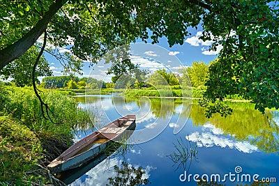 Spring summer landscape blue sky clouds river boat green trees