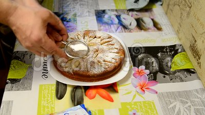 Sprinkle / decorate the homemade cake with powdered sugar. stock video footage
