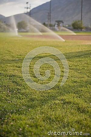 Free Sprinklers Watering Field Stock Photos - 3028203