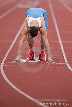 Sprinter in the starting blocks