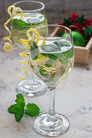 Free Spritzer Cocktail With White Wine, Mint And Ice, Decorated With Spiral Lemon Zest Stock Image - 80891821
