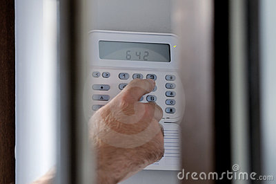 Spying a man arming a burglar alarm system