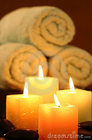 Square candles before towel