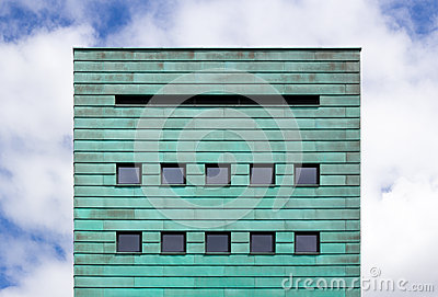 Square facade with copper strips