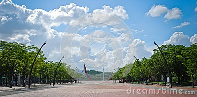 Square of public park with blue sky and clouds