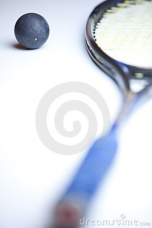 Squash ball and  racket on white background