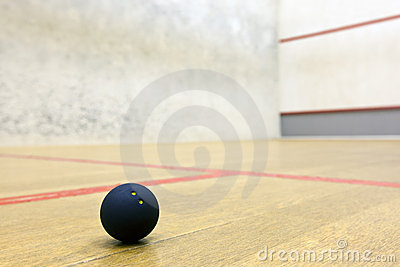 Squash ball in sport court