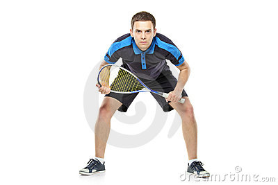Squash player preparing for service