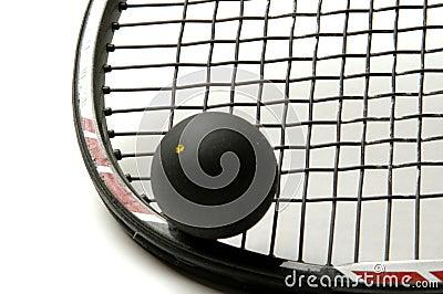 Squash racquet with squash ball