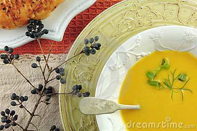 Squash Soup in White Bowl with Bread