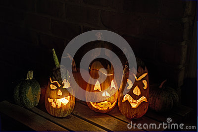 Squashes and carved eggplant lanterns at halloween