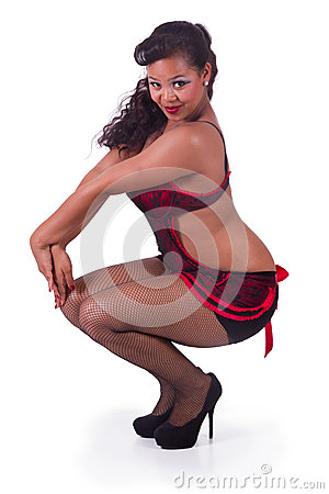 Squatting pinup in red and black