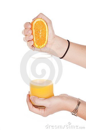 Squeezing orange into glass
